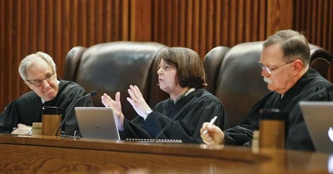 Top Kansas court: State not properly funding poor schools