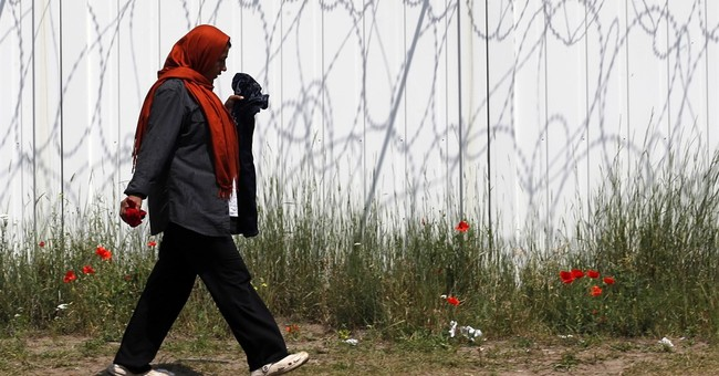 The Latest: Hungary to open 3rd passage on Serbia border