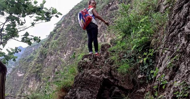 Chinese kids who climb cliffside ladder home will get stairs