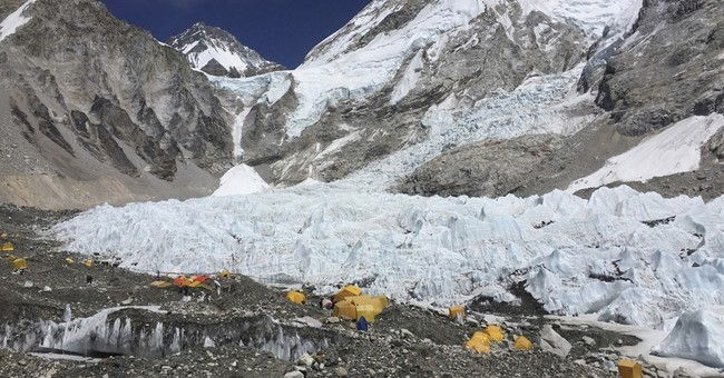 Death on Everest leads to risky effort to recover bodies