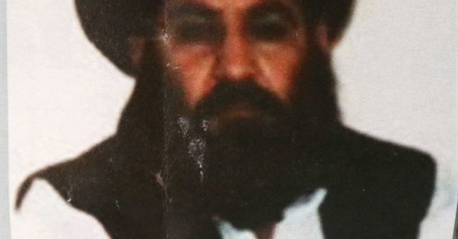 Pakistan arrest 2 officials for helping slain Taliban chief