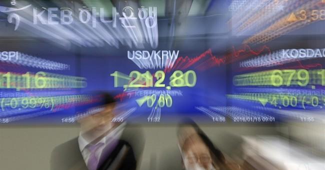 Global stock markets slide, oil falls below $30 a barrel