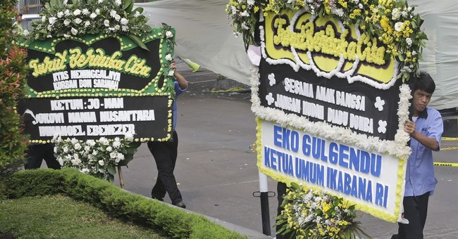 AP PHOTOS: Jakarta tries to get back to normal after attacks