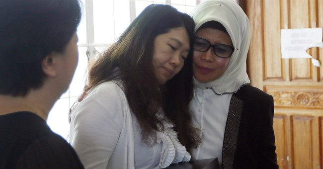 AP Exclusive: Kin of Malaysian hostage retrieve remains