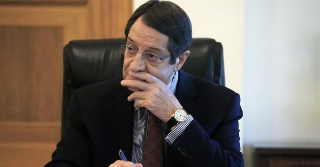 AP Interview: Cyprus president spurns haste in peace talks