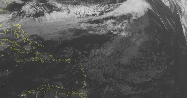 Rare January hurricane weakens to tropical storm