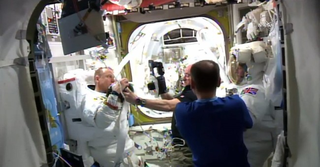 Spacewalk aborted after water leaks into astronaut's helmet