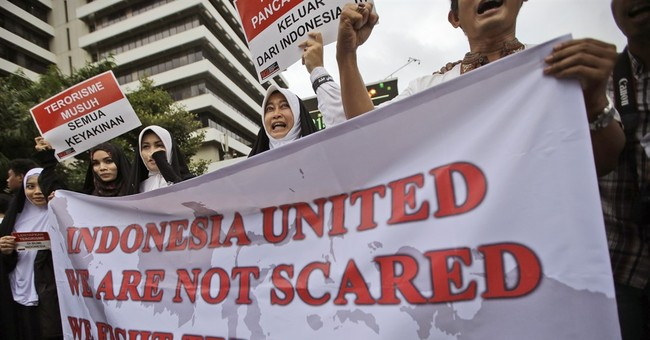 The Latest: Vigil held at site of Jakarta attack