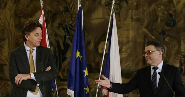 The Latest: Dutch FM calls for EU unity in migrants crisis
