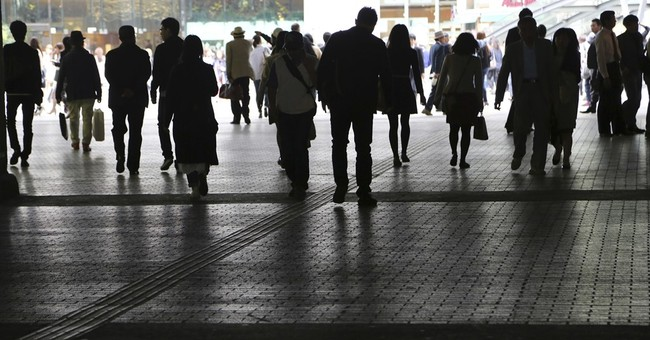 Abe to put off tax hike to mute shocks to faltering economy
