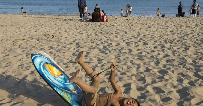 The Latest: Some beaches open after California shark attack
