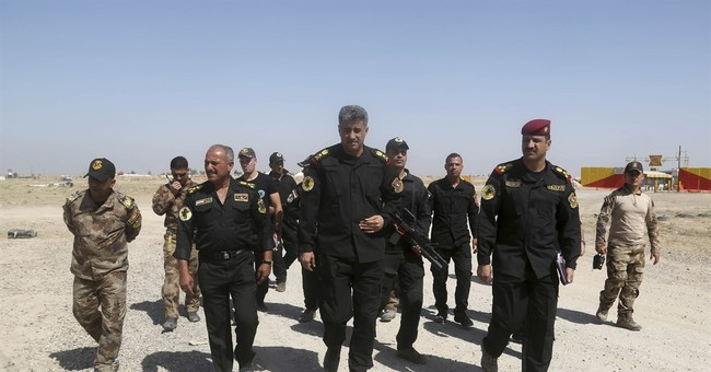 The Latest: Iraqi forces start pushing into IS-held Fallujah