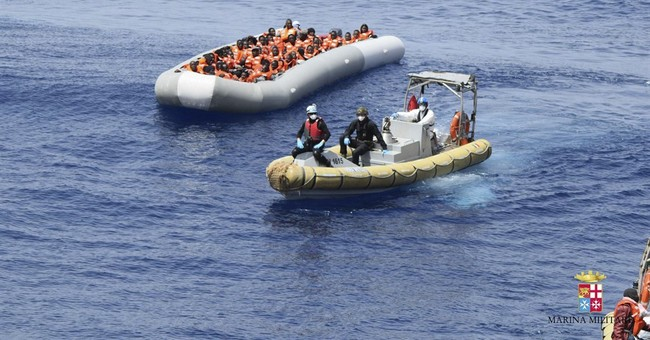The Latest: Italy breaks up unofficial migrants' tent camp