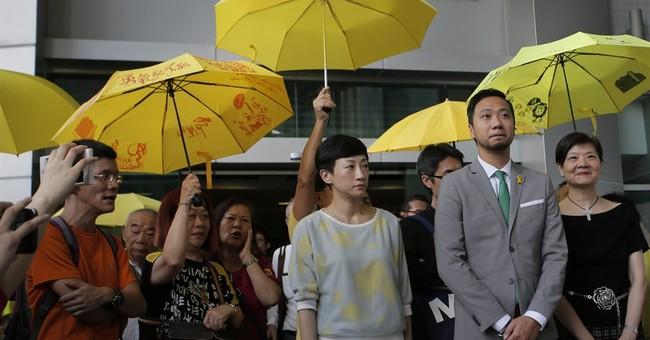 Hong Kong activist beaten by police sentenced to prison