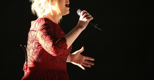 Adele calls out fan for filming show instead of watching it