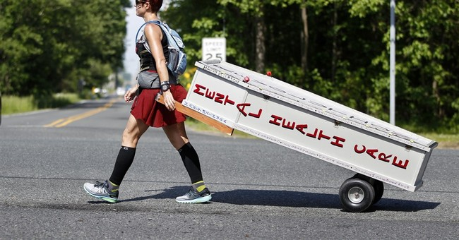 Woman pulls casket for miles for mental health awareness