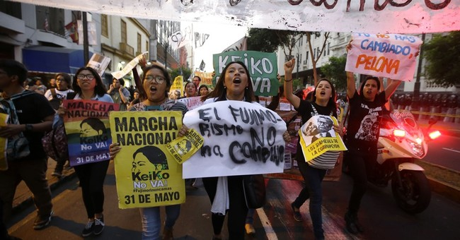 Thousands march in Peru to oppose Fujimori before election