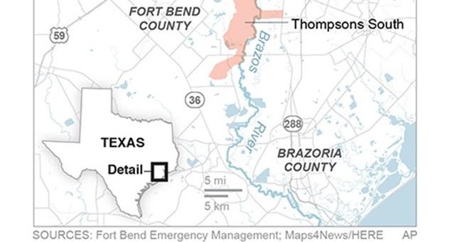 Swollen river feeds flooding near Houston as residents flee