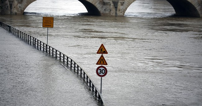 Rain pummels France; Seine overflows its banks in Paris