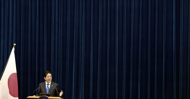 Abe puts off tax hike to mute shocks to faltering economy