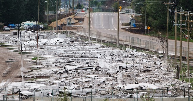Residents return to fire-damaged western Canadian oil city