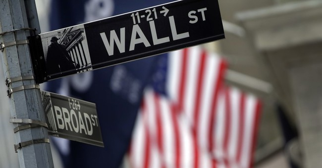 US stocks trade mixed after weak reports on autos, China