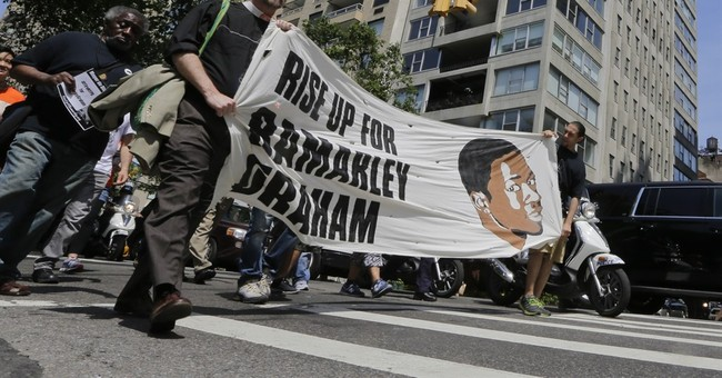 Backers of black teen shot by white cop march through NYC