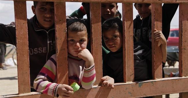 Syria refugees kept behind fences amid Jordan security fears