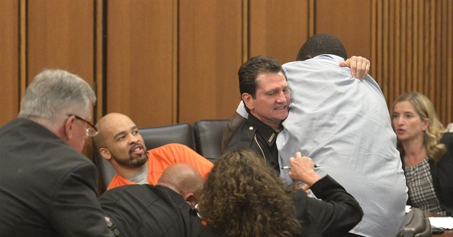 Victim's dad jumps over table to attack her killer in court