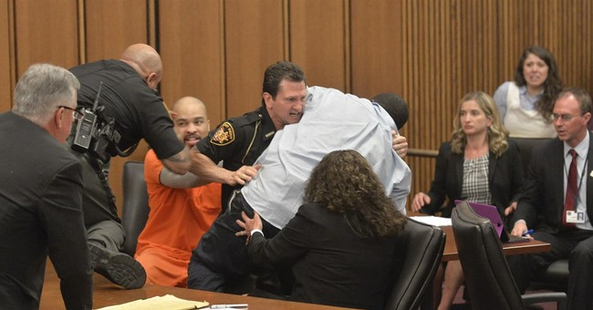 Man says he lunged at daughter's killer in court over smile