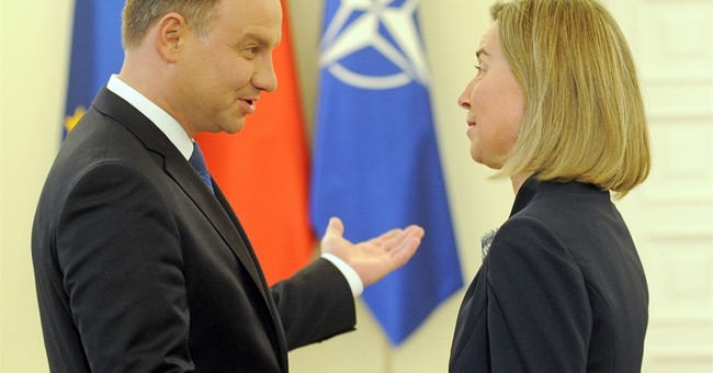 Poland dismisses EU criticism as unwarranted, non-binding