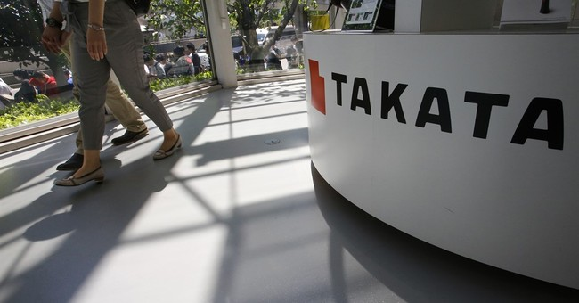 GM says its Takata inflators are safe; government disagrees