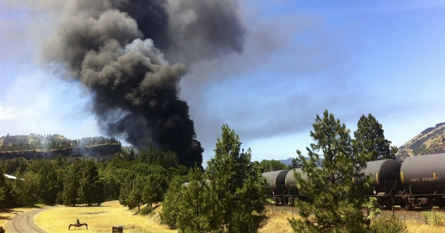 The Latest: Several cars ablaze in Oregon train derailment