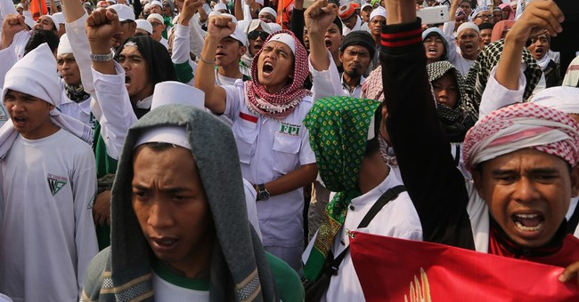 Indonesian Muslim hard-liners hold anti-communist protest