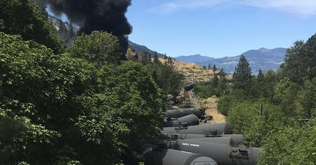 The Latest: 14 cars on oil train derailed, 4 caught fire