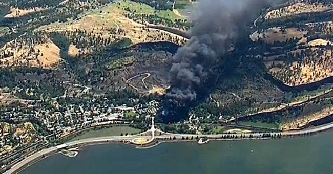 Crews work to contain sheen after Oregon train derailment