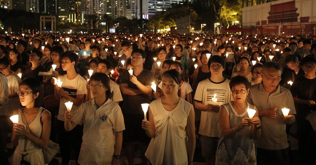 Hong Kong students split from Tiananmen anniversary vigil