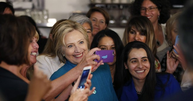 Clinton says toddler granddaughter Charlotte cheers her on