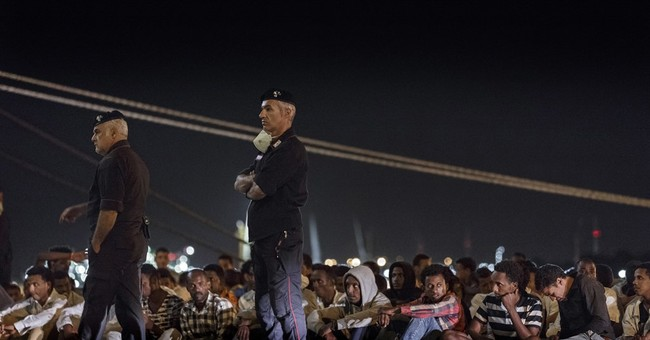 Austria suggests interning migrants on Greek islands