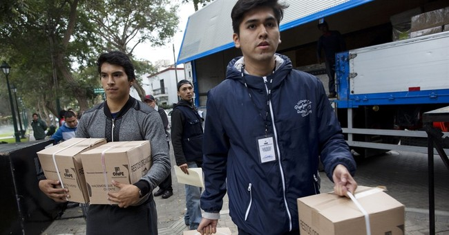 The Latest: Partial results give slim lead to Kuczynski