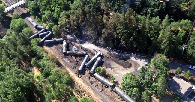 The Latest: Oregon leaders want temporary stop to oil trains