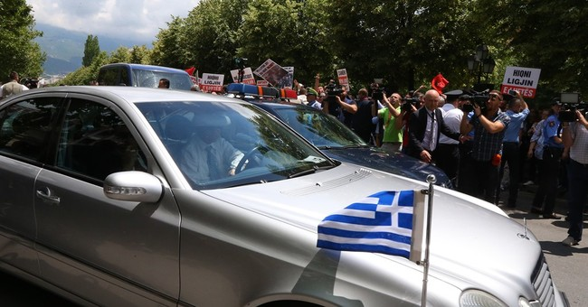 Greek minister's visit to Albania greeted with a protest