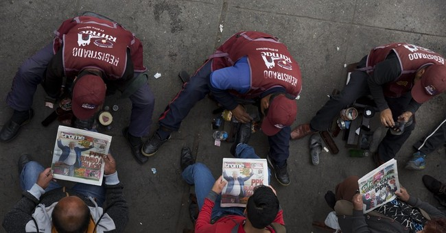 Conservative economist narrowly ahead in Peru election