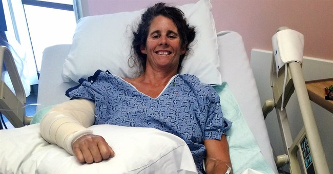 Bandaged shark bite victim is all smiles in hospital photo