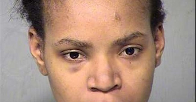 The Latest: Mother accused of killing young sons is jailed