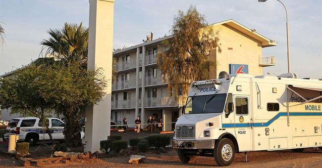 Man kills 2 in Phoenix motel lobby before killing himself