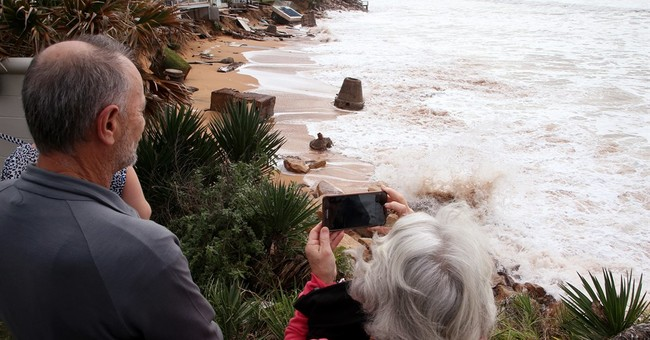 3 die in floodwaters as strong storm lashes Australia's east