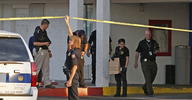 Man kills 2 in Phoenix motel lobby before killing himself