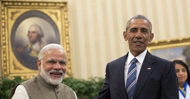 Obama meets Indian PM, seeks implementation of climate pact
