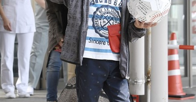 Abandoned Japanese boy leaves hospital; no charges planned